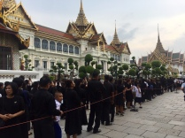 Thai people lining up in front of the Grand Palace to mourn their King